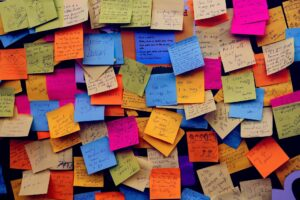 A haphazard collection of post-it notes on a wall